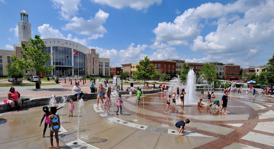 Children playing in water fountain in front of City Hall in Suwanee GA