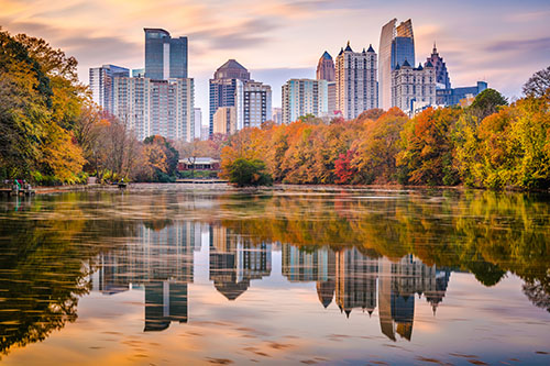 Atlanta, Georgia, USA Piedmont Park skyline in autumn on Lake Meer at dusk.