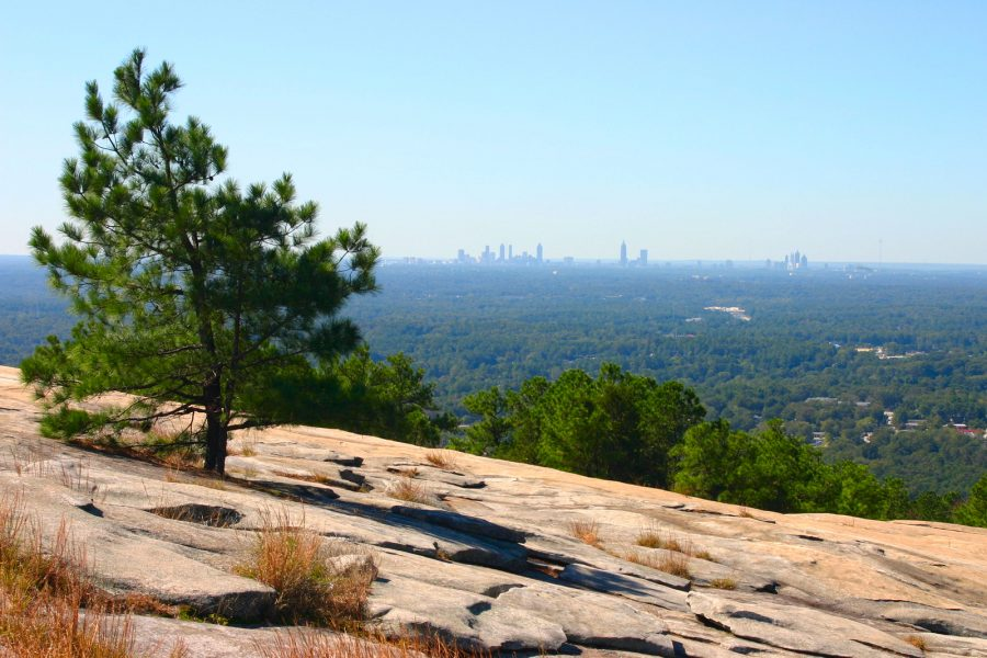 Side shot of Stone Mountain with the Atlanta skyline in the background.